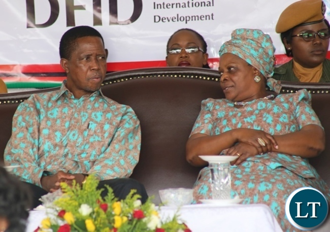 President Edgar Lungu chatting with first lady Esther Lungu during this year's international women's day celebrations in the show grounds in Lusaka. Picture by SUNDAY BWALYA/ ZANIS