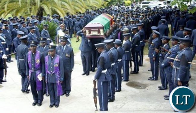 ZAF officers at the Cathedral of the Holy Cross carrying the casket of their deceased colleague