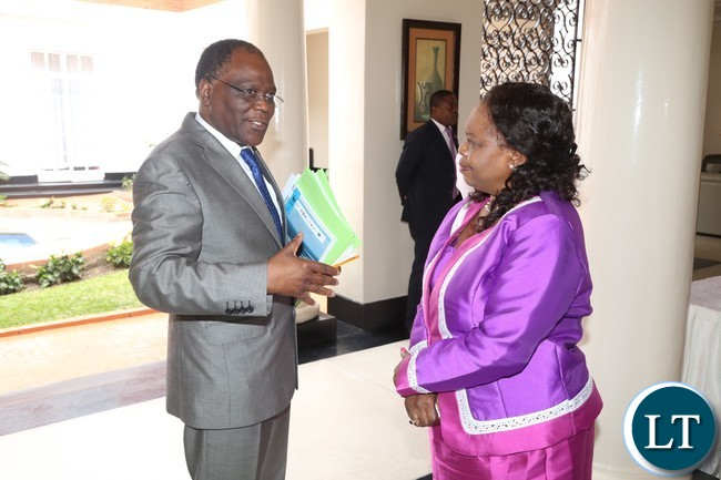 Secretary to the Cabinet Rowland Msiska speaking to Minister of Religious Affairs and National Guidance Godfridah Sumaili shortly after presentation of of the 2016 Quarterly Report at State House yesterday 23-03-2017. Picture by ROYD SIBAJENE/ZANIS
