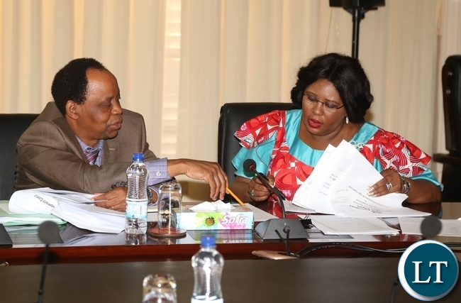 Minister of Agriculture Dora Siliya and her Permanent Secretary Julius Shawa sharing notes during the presentation of the 2016 Quarterly Report from Ministry of Agriculture at State Hous