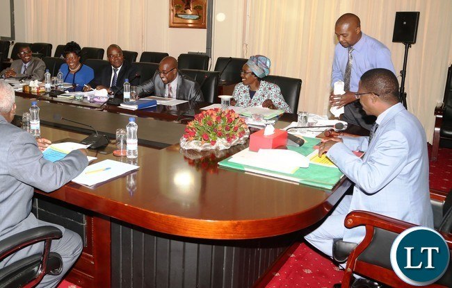 President Edgar Lungu flanked by Vice President Inonge Wina having a light moment with Minister of Transport and communication Brain Mushimba and his technocrats during the presentation of the quarterly report 2016 at State House