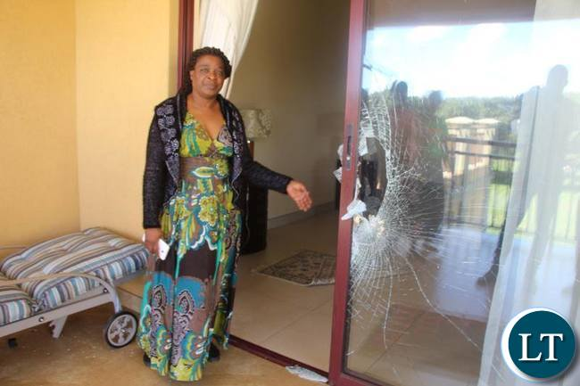 Mutinta Hichilema shows the extent of the damage done to the house