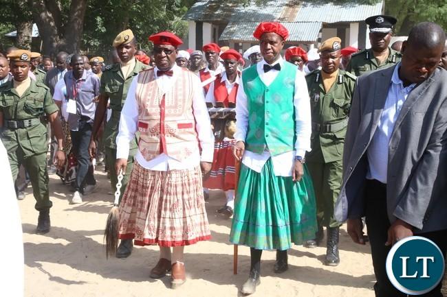 President Edgar Lungu and His Majesty King Lubosi Imwiko ii of the Lozi people walking majestically heading Board to the Nalikwanda for Limulunga at Lealui Palace