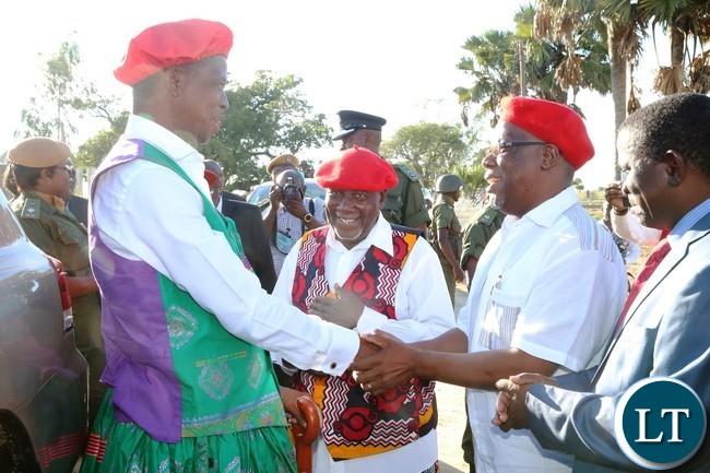 Western Province Minister Nathaniel Mubukwanu welcomes President Edgar Lungu whilst the Ngambela Nyambe Mweenda looks on at Lealui Palace