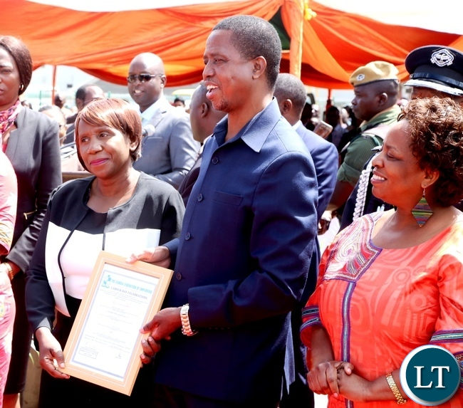 President Edgar Lungu presents a certificate to Doreen Makanta of Barclays Bank for the Most Honest worker award during 2017 Labour Day Celebration at Freedom Statue whilst Minister Labour of Joyce Simukoko looks on yesterday 01-05-2017. Picture by ROYD SIBAJENE/ZANIS