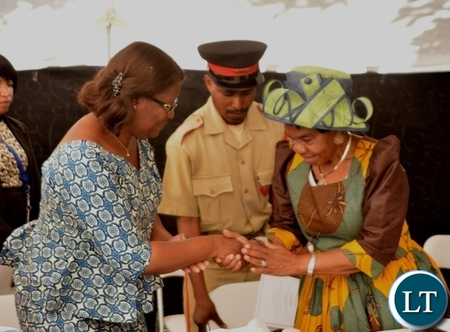 Minister in the Office of the Vice President Sylvia Chalikosa(l) congratulates Her Royal Highness Senior Chieftainess  Nkomeshya Mukamambo II after giving her keynote speech at the Peace Corps Swearing in Ceremony for Environment and Aqua-Culture Volunteers in Lusaka