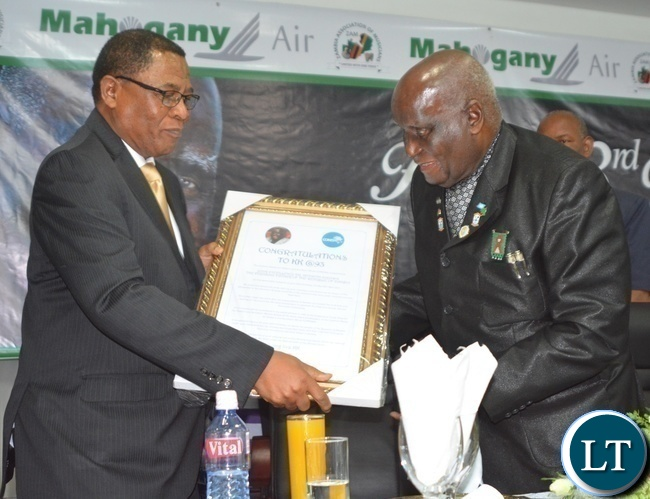 COMESA Secretary General Sindiso Ngwenya(r) presents a gift to First Republican President Kenneth Kaunda(l) during Zambia Association of Musician KK's Birthday Bash in Chongwe