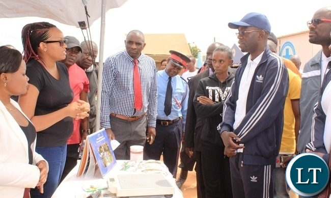 Copperbelt Province Permanent Secretary, Elias Kamanga, visits some stands after he launched the National Health Week at Wusakile Ground in Kitwe