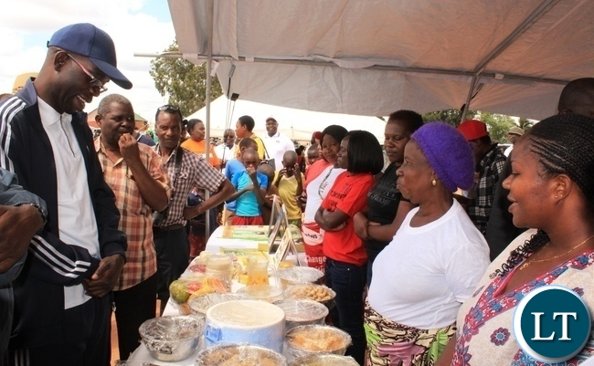 Copperbelt Province Permanent Secretary, Elias Kamanga, admires some of the healthy foods that were displayed by the Ministry of Health and the Ministry of Agricultrure during the launch of the National Health Week at Wusakile Ground in Kitwe