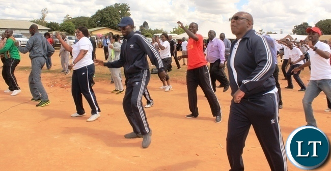 Copperbelt Province Permanent Secretary, Elias Kamanga leads heads of government departments in doing aerobics after he launched the National Health Week at Wusakile Ground in Kitwe