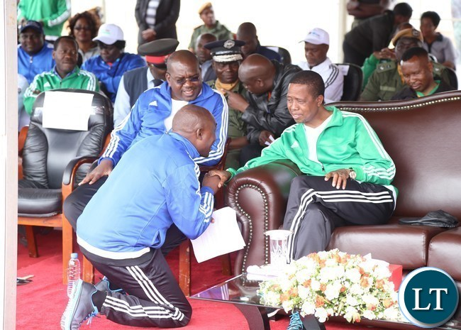 President Edgar Lungu confers with Lusaka Province Minister Japhen Mwakalombe during the official launch of the 2017 National Health Week at the Olympic Youth Development Centre