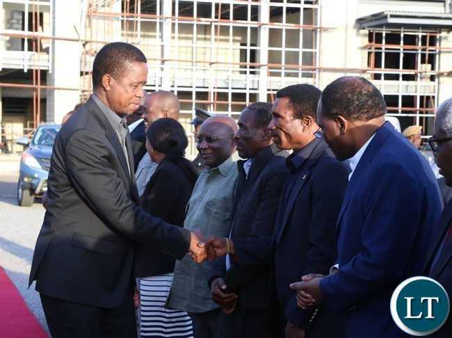 President Edgar Lungu greets Livestock and Fisheries Minister Micheal Katambo at City Airport on his way to Chinsali District to attend the burial of the late freedom fighter Salome Kapwepwe