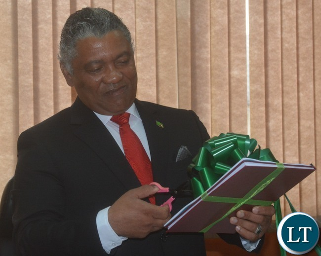 Minister of Justice Given Lubinda unveils Criminalization of Torture in Zambia Project Report and Draft Bill just after the handover ceremony at his office