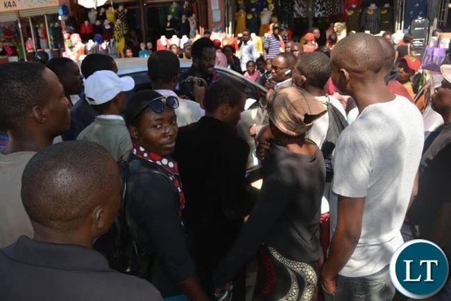 Dr Savior Chishimba adddresses media at Luburma Market as some traders look on
