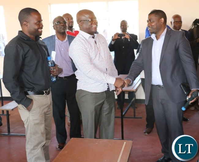 From L-R Bupalo Ward Councillor Nelius Mumba, KCM PR and Communications Manager Shapi Shachinda, Nchanga MP Chali Chilombo and KCM Community Relations Manager Brian Siatubi in one of the newly handed over classrooms