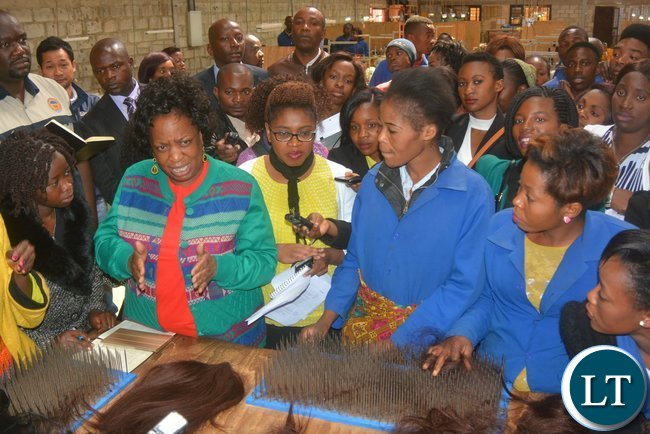 Minister of Labour Joyce Nonde talks to Eve's Hair Production workers during the inspection of the Eve 'S factory in Lusaka yesterday, Picture by Josephine Nsululu/Zanis.