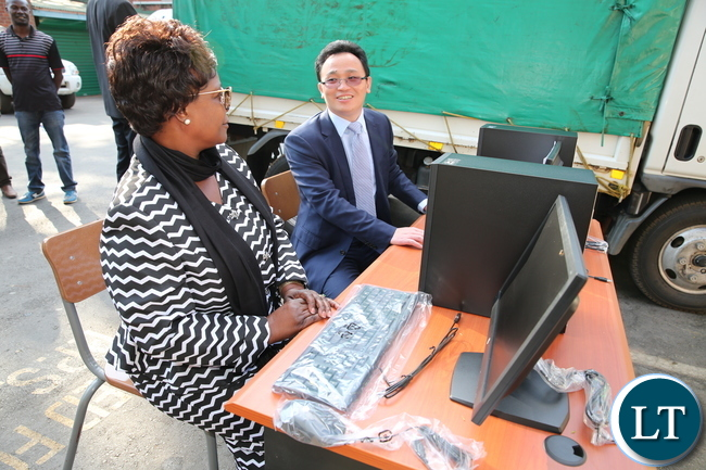 First Lady Esther Lungu speaks with Huawei Technologies Zambia Managing Director Thomas Hu at State House where Huawei donated Computers to Esther Lungu Foundation Trust on August 14,2017-Pictures by THOMAS NSAMA