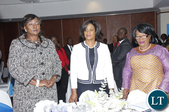 """Higher Education Minister Professor Nkandu Luo, Community Development and social welfare Minister Emerine and Baclays Bank PLC CEO Mizinga Mehlu interacting during the""""Barclay's Bank scholarship"""" launch at Lusaka Pamodzi Hotel on Tuesday, 1st August 2017."""