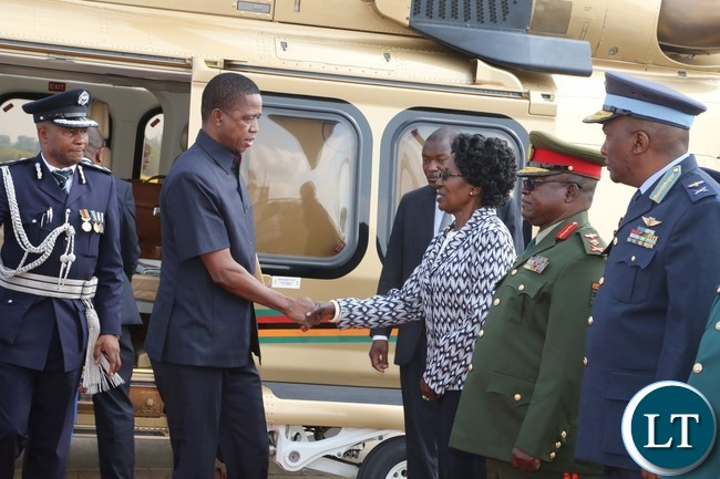 President Edgar Lungu greets Vice President Inonge Wina shortly before departure to Botswana whilst Zambia Army Commander Paul Mihova (2nr) Deputy Zambia Air Force commander David Muma (r) at Kenneth Kaunda International Airport