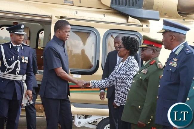 President Edgar Lungu greets Vice President Inonge Wina shortly before departure to Botswana whilst Zambia Army Commander Paul Mihova (2nr) Deputy Zambia Air Force commander David Muma (r) at Kenneth Kaunda International Airport
