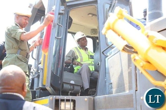 President Edgar Lungu dismaberk from the cartapillar during the commissioning of the construction works of the Lusaka-Ndola dual carriageway costing $1.2Billion in chibombo