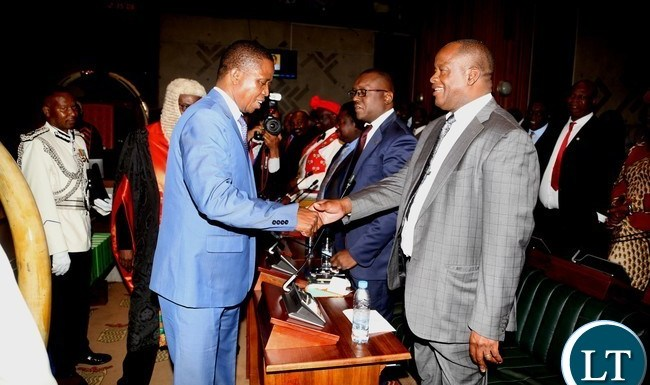 President Edgar Lungu shaking hands with UPND members parliamenet Jack Mwaimbu shortly after the official opening second session of twelfth Assembly at parliament