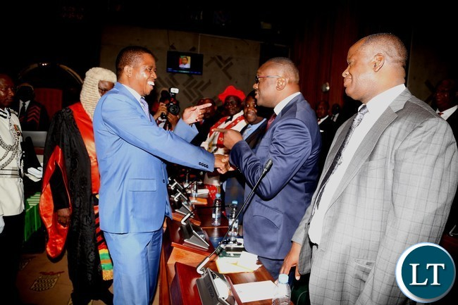 President Edgar Lungu having a light moment with UPND members Parliament Garry Nkombo shortly after the official opening second session of twelfth Assembly at parliament