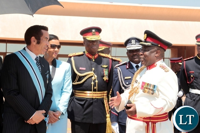 PRESIDENT Seretse Khama Ian Khama confers with Col .Chewe  after seeing off President Edgar Lungu at Sereste Khama International Airport