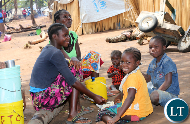 Congo DRC refugees family meal time at Kenani camp transit centre in the Nchelenge