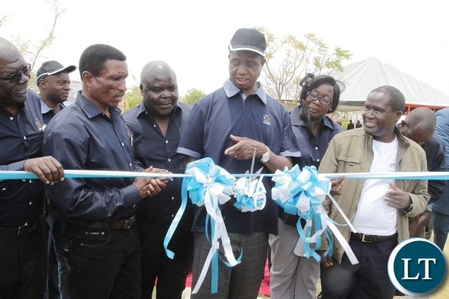 President Edgar Lungu cuts the ribbon to officially launch the Zambia Aquaculture Enterprise Development Project in Lilayi