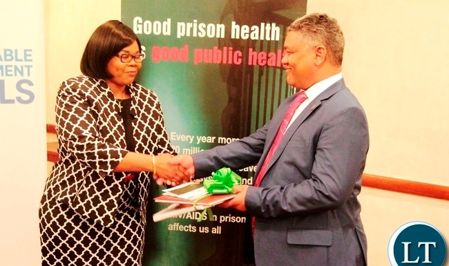 Zambia Law Development commission Justice Roydah Kaoma shakes hands with Justice Minister Given Lubinda after presenting the Law Reform Project Report on the review of prisons Act and Allied Legislation at Southern Sun Hotel in Lusaka