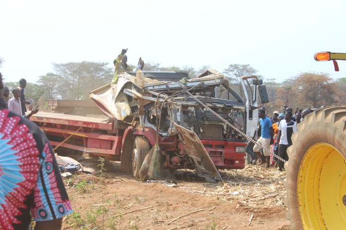 A Zambeef tractor pulls the cabin of a truck in a bid to set free the deceased driver who was trapped in the motor vehicle for over 5 hours following an accident along the Chowa Lukanga Road in Mpongwe this morning. Picture by Noah Kangali. (ZANIS)