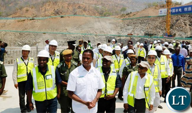 President Edgar Chagwa Lungu (centre) flanked by ZESCO Managing Director Victor Mundende (right) and Kafue Gorge Lower Hydro Power Project Director Wesley Lwiindi (left) during the River Diversion Ceremony at Kafue Gorge in Chikankanta District of Southern Province on Wednesday,October 4,2017. PICTURE BY SALIM HENRY/STATE HOUSE ©2017