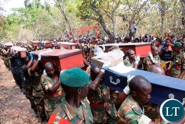 Pall-Bearers during a ceremonial burial for the 17 accident victims held at Mambwe Mission in Senga district today. The Isuzu truck Reg No ACK 5871 which was carrying over 60 Members of the Catholic church overturned after losing brakes. Several other people are still admitted to Mbala and Mpulungu hospitals with head inquires.-Picture by Mary Bwembya (ZANIS)