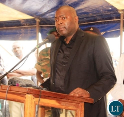 Copperbelt Province Minister, Bowman Lusambo, addresses mourners at the burial of former Cabinet Minister in Kenneth Kaunda's government, Cosmas Chibamba at Nakatungu Farm in Mpongwe District on Friday. Picture by TISA BANDA-NKHOMA/ZANIS.