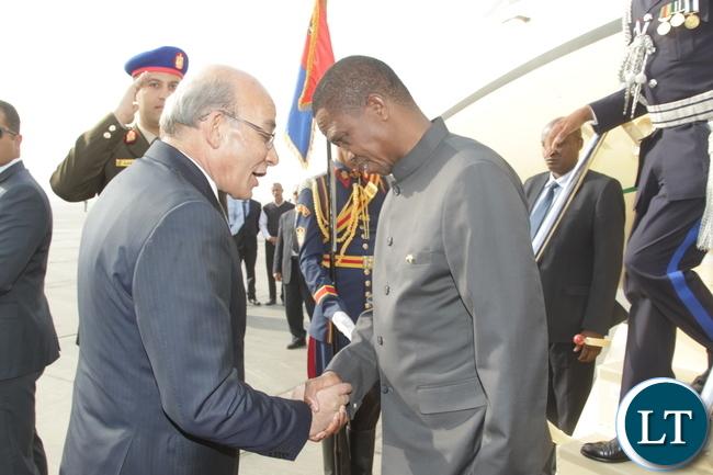 President Edgar Lungu talks to Egyptian Agriculture Minister Abd Almnaem Albna on arrival at Cairo International Airport in Egypt