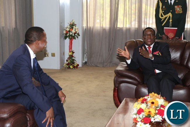 President Edgar Lungu chats with Newly sworn in Zimbabwean President Emmerson Mnangagwa during private talks at Sheraton hotel in Harare