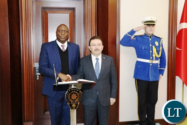 Inspector-General of Police Kakoma Kanganja shakes hands with Turkish National Police Director-General Selami Altinok shortly after signing a visitors' book at the Turkish National Police headquarters in Ankara yesterday-Picture by JERRY MUNTHALI