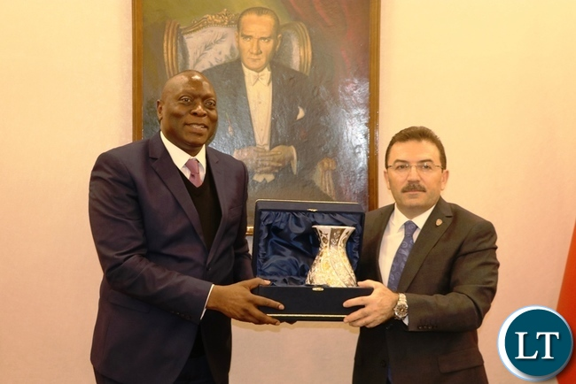 Turkish National Police Director-General Selami Altinok presents a gift to Inspector-General of Police Kakoma Kanganja in Ankara yesterday-Picture by JERRY MUNTHALI