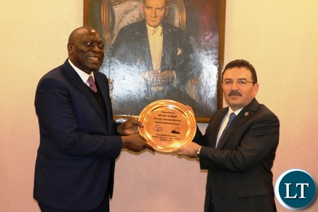 Inspector-General of Police Kakoma Kanganja presents a gift to Turkish National Police Director-General Selami Altinok in Ankara yesterday-Picture by JERRY MUNTHALI