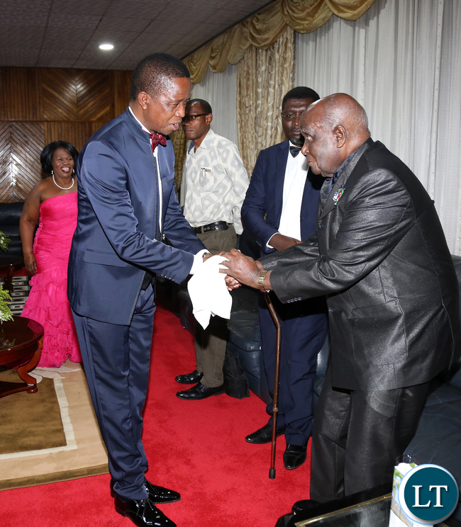 President Edgar Lungu with Dr Kenneth Kaunda at UNZA Alumni fund rasing Dinner dince at mulungushi international Conference centre last night.