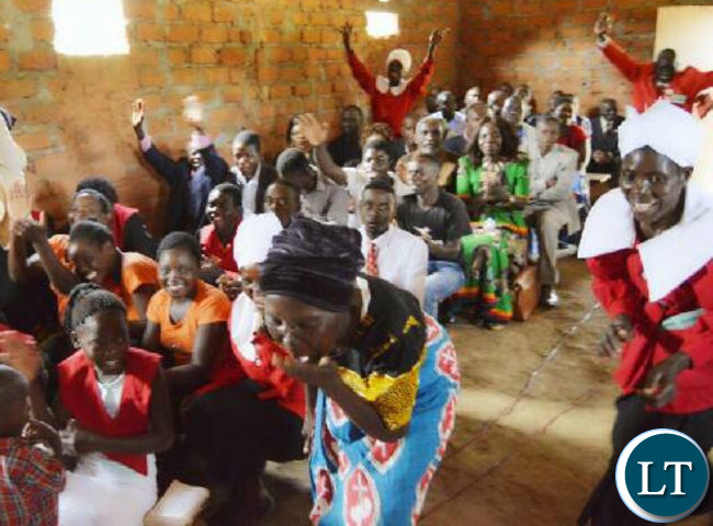 The the congregants break into celebration after learning of the K10 000 donation