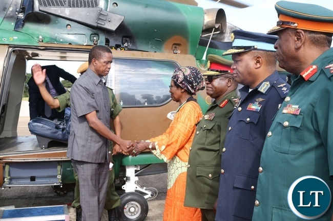 Vice President Inonge Wina receives President Edgar Lungu at ZAF Lusaka shortly before his departure to Muchinga Province for three days working visit whilst Service Chiefs looks on