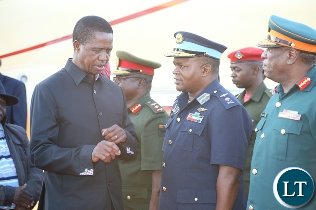 -President Edgar Lungu confers with Zambia Air Force Commander Lt. Gen. Eric Chimese shortly after his arrival from Muchinga Province at ZAF Lusaka Airport