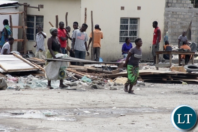 Traders comply during the demolition exercise and closure of Kaoma-Kaoma Market make-shift structures as a preventive measure against the outbreak of Cholera in Mongu