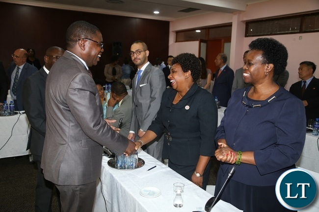 Minister of Foreign Affairs Joe Malanji having a light moment High Commissioner of Kenya to Zambia Sophy Kombe during the Diplomatic Corps and High Commissioners accredited to Zambia meet with the newly appointed Minister of Foreign Affairs at Mulungushi International Conference Centre
