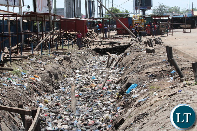Lumumba drainage along City Market bus station before and after.