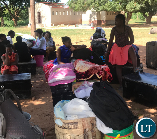Some of disappointed learners of Chongwe's Mukamambo Girls Boarding School pupils waiting for transport back home after the school was abruptly shut