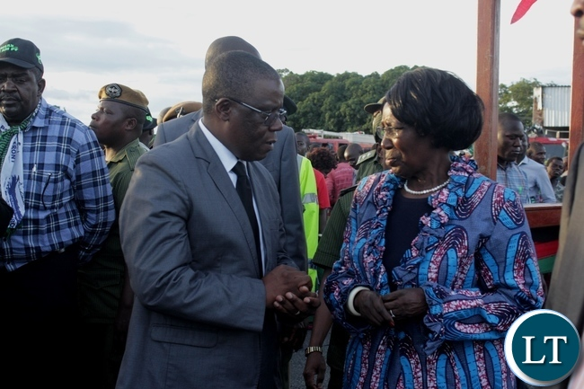 Vice President Inonge Wina (r) confers with Western Province Minister Nathaniel Mubukwanu (l) on arrival at Mongu Airport for a two-day working visit to inspect government developmental projects in the province
