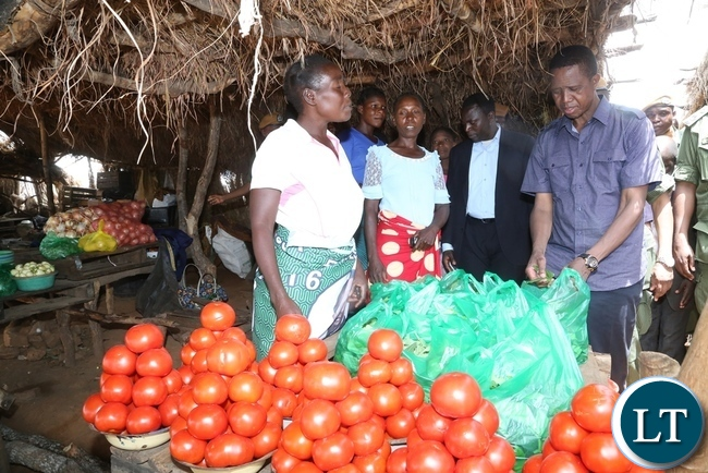 President Edgar Lungu buying vegetables at John Chinena during the tour of Chibombo District in Central Province
